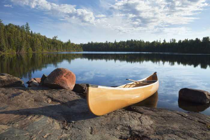 Fishing canoe along the rocky shores of a Minnesota lake