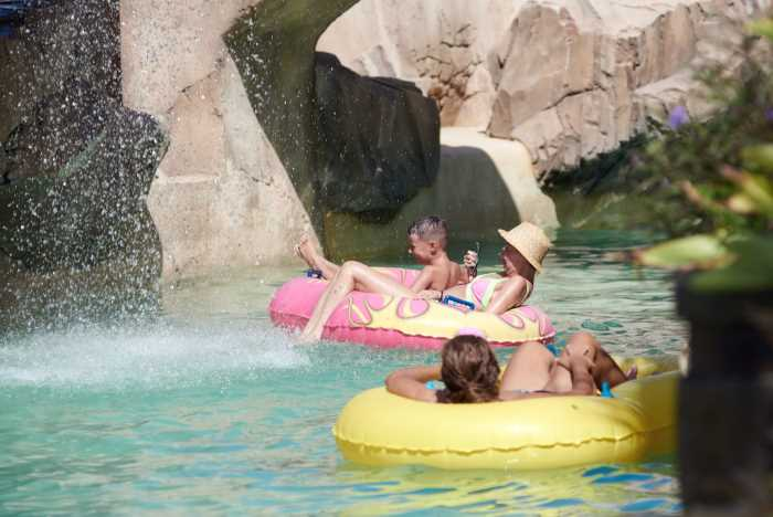 people floating down a lazy river