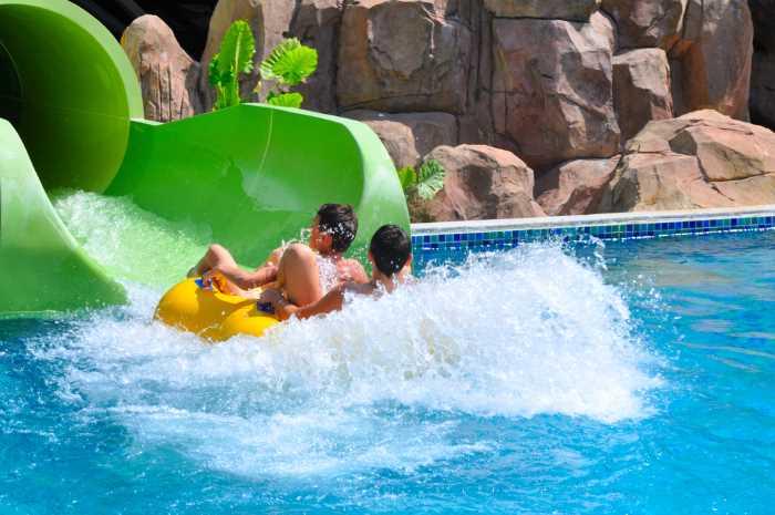 coming down a water slide on an innertube.