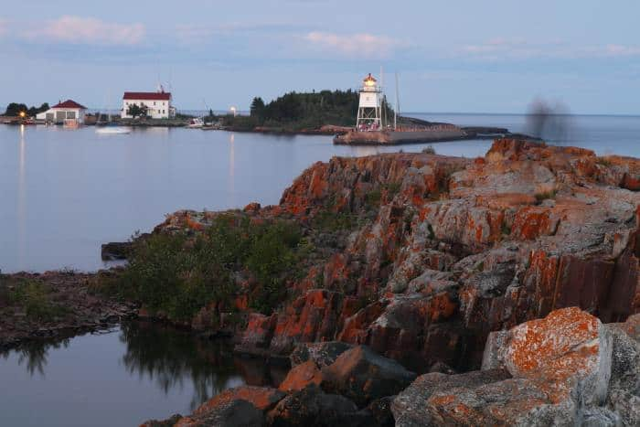 Rocks and lighthouse on lake