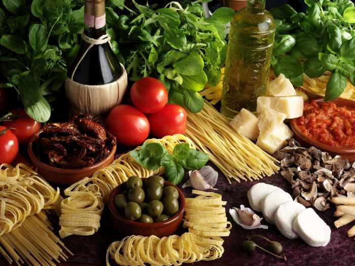 Fresh assorted Italian ingredients on a table.