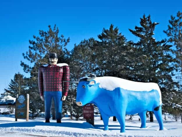 Sculptures of Paul Bunyan and Babe the Blue Ox in the snow in Bemidji, one of the best places to visit in Minnesota.