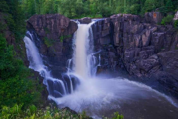 View of High Falls waterfalls in Grand Portage -- one of the best places to visit in Minnesota.