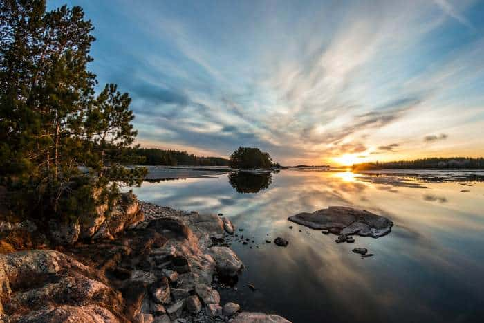 While camping in Minnestora, enjoy a Sunset over water at Voyageurs National Park