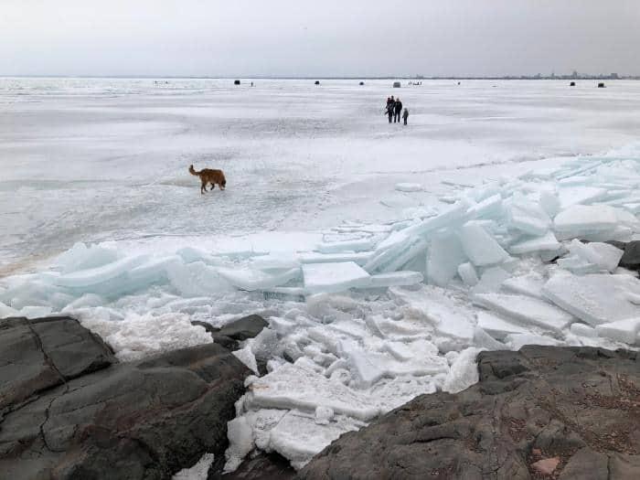Ice fishing on frozen lake.