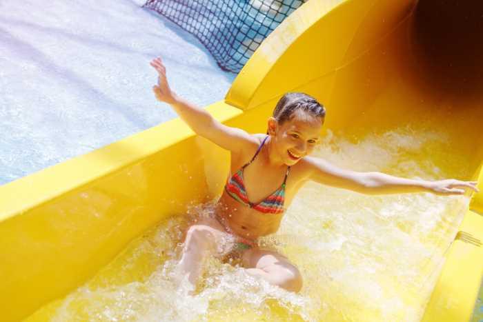 girl on waterslide at an indoor waterpark