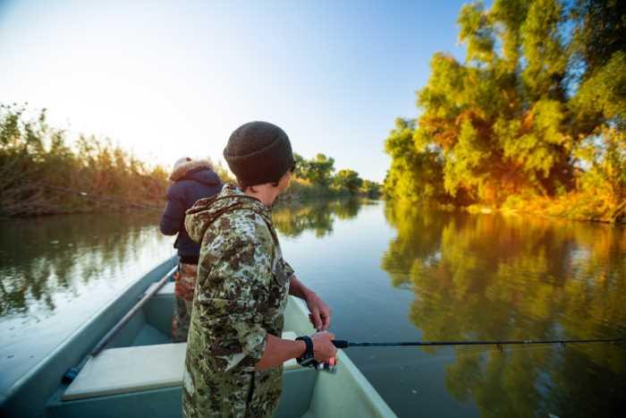 two men fishing in a boat