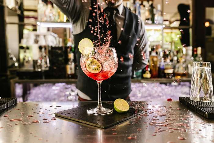 Specialty cocktail being made by bartender