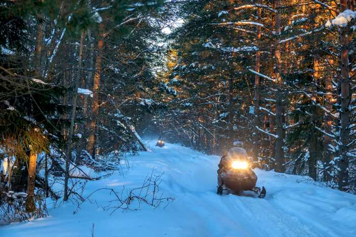 snowmobile riding in the winter at one of the best lake resorts in Minnesota