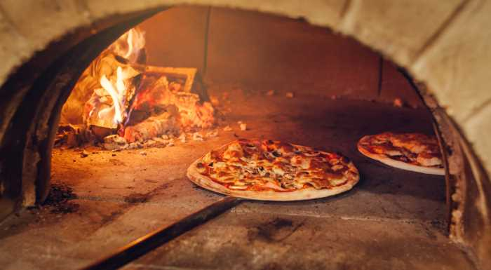 pizza cooking in a wood fire oven.