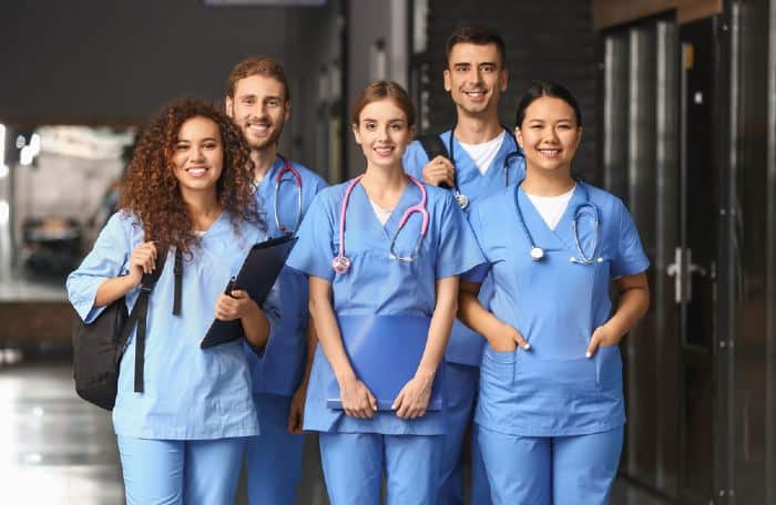 Group of students in corridor of one of the best colleges in Minnesota for pre-med.