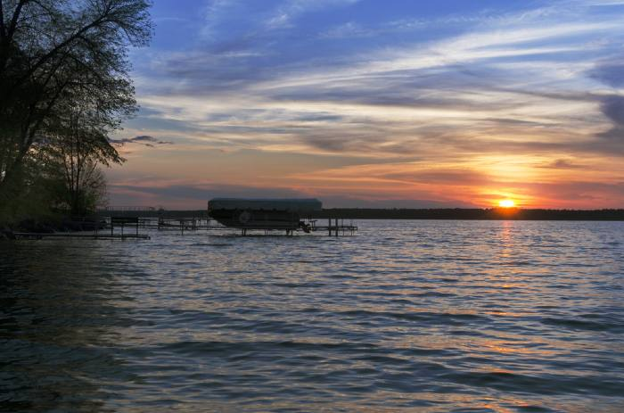 Sunset With A Single Boat Over Leech Lake